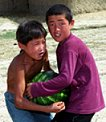 Boys with a melon - Kyrgyzstan